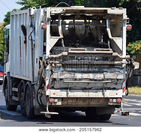 Garbage truck on the street in the city