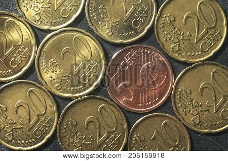 Various euro cent coins mosaic on a gray background