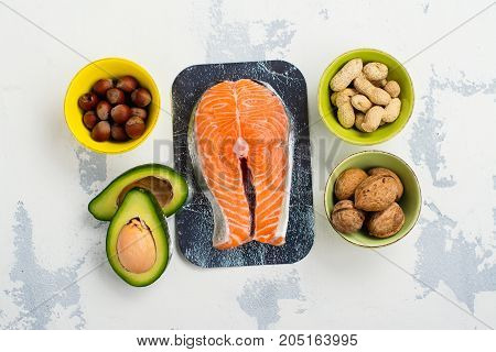 Assortment of food - sources of unsaturated fats and omega-3. Space for text