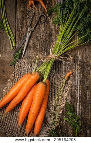 Red carrot on wooden background table. Top view carrot concept.