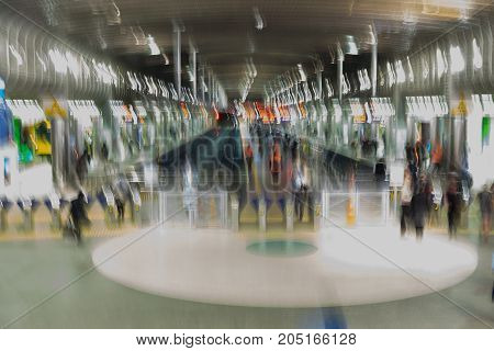 Abstract impressionist background of commuters at Britomart rail train transportation centre in Auckland New Zealand NZ