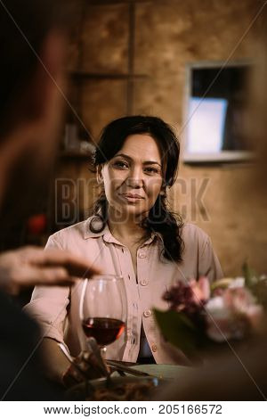 beautiful mature asian woman drinking wine and smiling