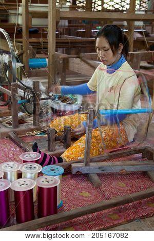 Woman Creating Thread At A Silk Factory