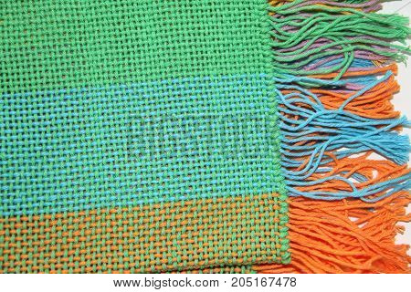 colorful knitted garments and blankets comb loom