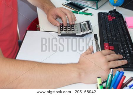 Hand with calculator. Finance and accounting business. Business male Analyzing Statistics Financial business Concept