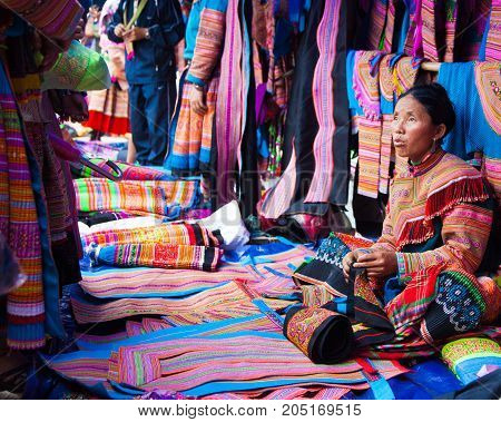 North Vietnamese Woman In Colorful Native Clothing Sells Similar Clothes At Bac Ha Market