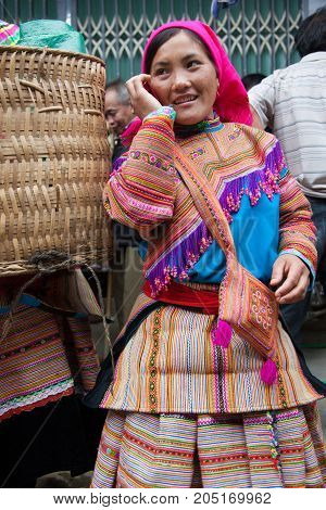 North Vietnamese Woman In Colorful Native Clothing At Bac Ha Market