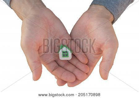 Man's hands hold small plasticine toy house isolated on white background. Buying a house concept.