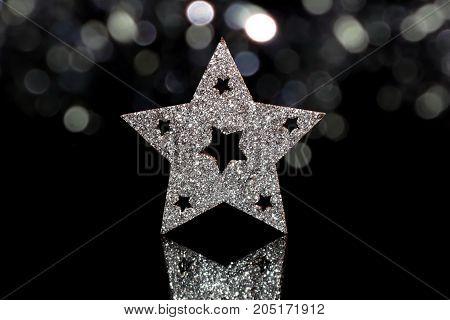 beautiful shiny Christmas star on a black background
