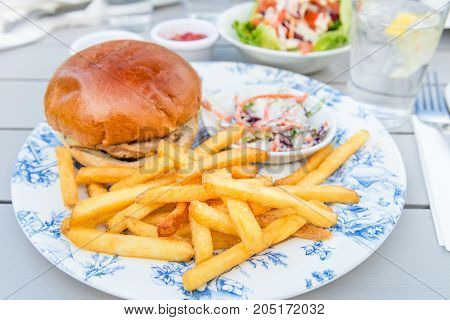 Burger And Chips With Coleslow Salad