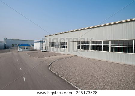 warehouse building in length. the facade of the factory in length