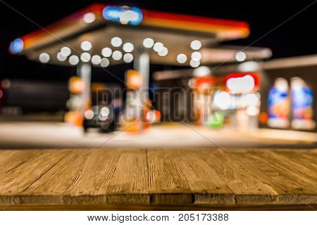 Blurred Image Of Gas Station In Lithuania At Night. Defocused Gas Station And Convenience Store In E