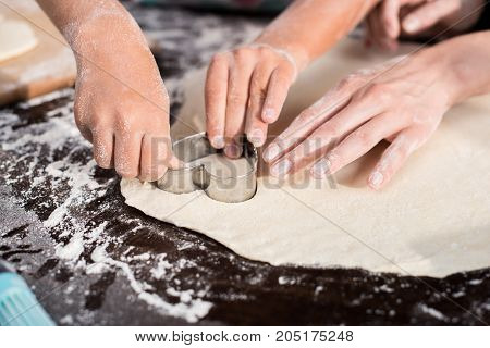 Family Cutting Out Cookie