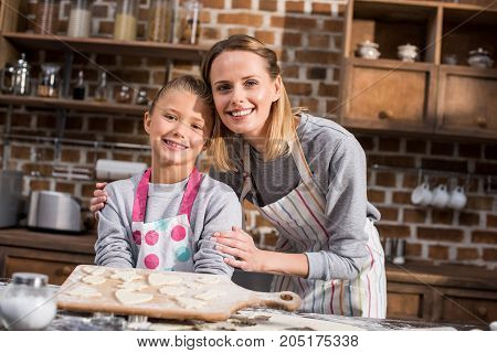 Child Holding Cookies On Cutting Board