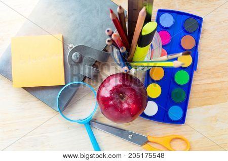 Education school toolsstudies accessories on Wood Background