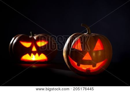 Two Halloween Pumpkins On A Black Background, studio shot