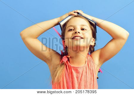 Pupil In Pink Dress With Braids And Pencils In Them