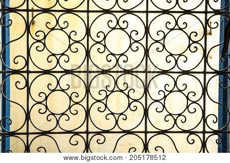 Traditional wrought iron window with flower shape Tangier Morocco
