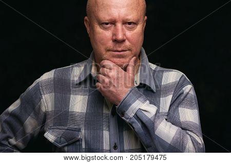 Confident Senior Man Thinking