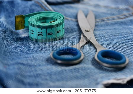 Tailors Tools On Denim Fabric, As Making Clothes Concept