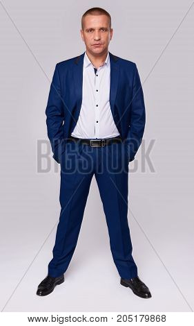 Full Length Portrait Of A Serious Businessman