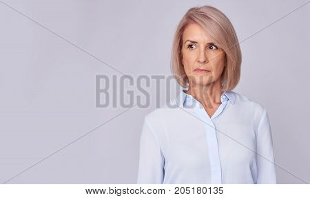 Serious Senior Woman Looking Away