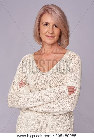 Senior Woman Looking At Camera With Charming Smile