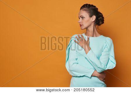 Pretty Woman Over Bright Orange Background
