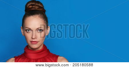 Portrait Of Pretty Girl Over Blue Background