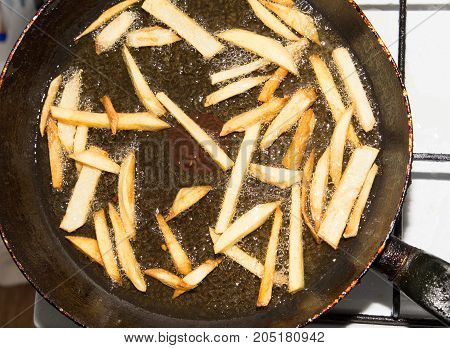 French fries are fried in a pan .