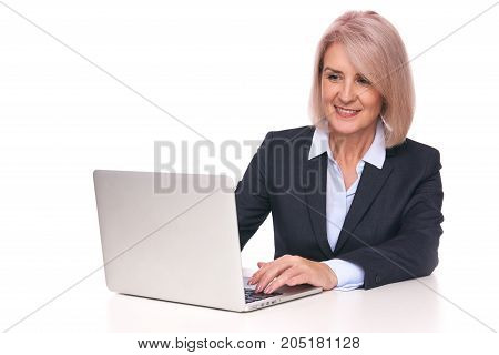 Senior Business Woman With Laptop. Isolated