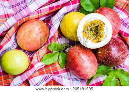 Red passion fruit with leaves on loincloth background