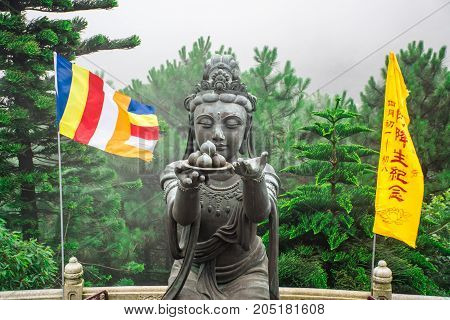 HONG KONG - MAY 31: Buddhist statue praising Tian Tan Buddha at Ngong Ping, Lantau Island, in Hong Kong