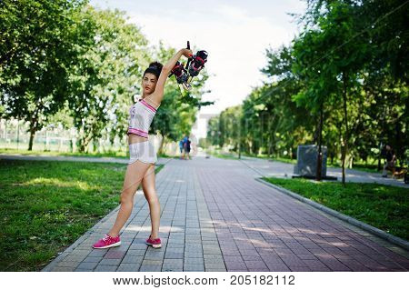 Sport Girl Wear On White Shorts Ans Shirt With Roller Skates At Park.