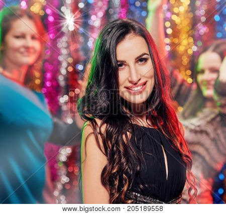 Young happy women enjoying nightlife and having fun together
