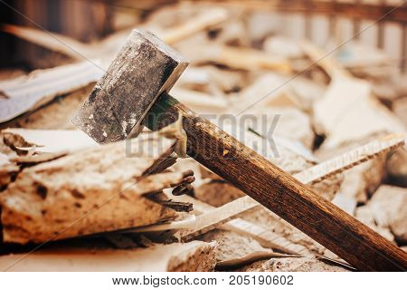Sledge-hammer And Broken Wall And Rubble