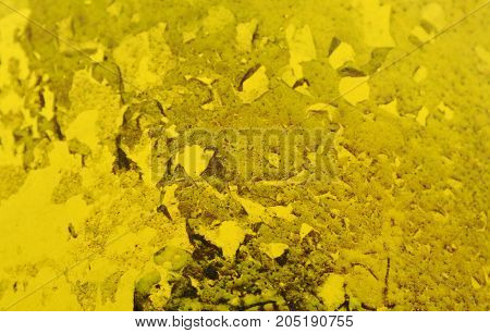 water and dry moss stain stuck on yellow plastic bin