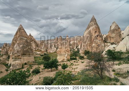 View of Gereme national park in Cappadocia Turkey. Textured clouds over endless bizarre landscapes. Incredible natural landscapes.