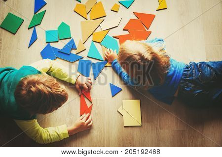 kids playing with puzzle in school or daycare, education concept