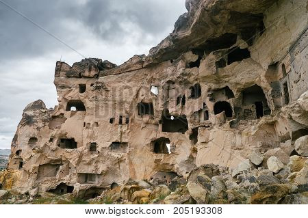 Natural fortress in the rocks in Uchisar Cappadocia Turkey. Incredible natural landscapes.