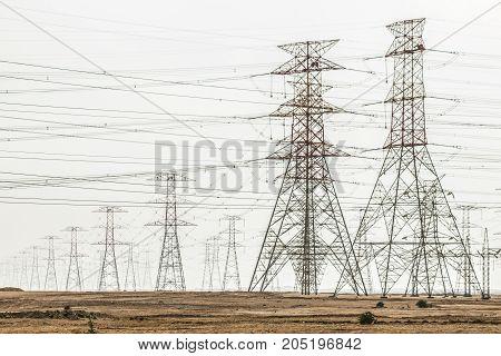 Dozens of power lines at the desert in Qatar