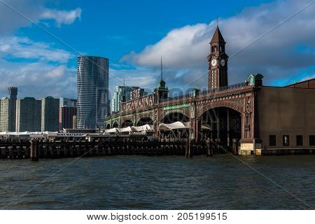 Hoboken NJ USA -- September 19 2017 -- The ferry docks of Hoboken with the Jersey City skyline in the background. Editorial Use Only.