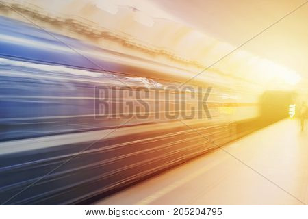 Urban life public transport. Metro train in fast speed moving. Blurred background of subway