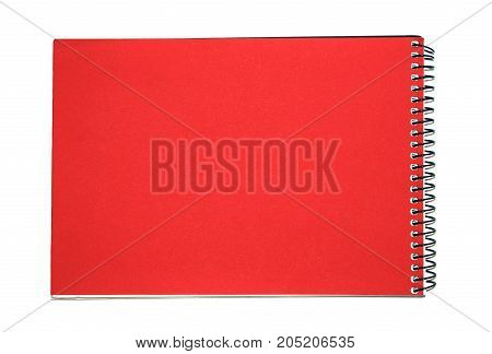Bright red notebook with a black cover on a white background