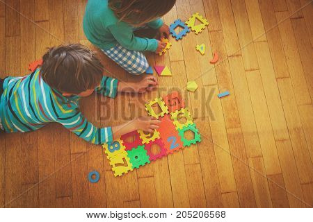 kids playing with puzzle, education and learning concept