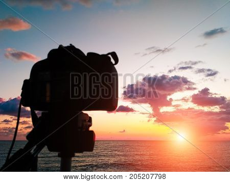 Capture Time-lapse Video On A Slr Camera. The Sun Goes Down The Horizon Of The Sea. Beautiful Sunset