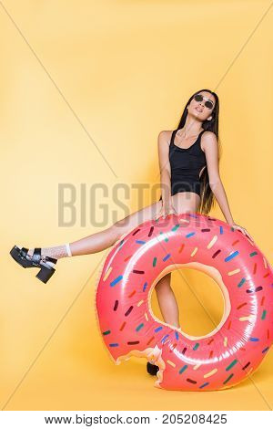 Woman With Doughnut Pool Float