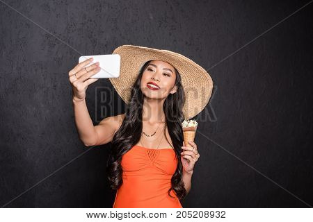 Woman Holding Ice-cream And Taking Selfie
