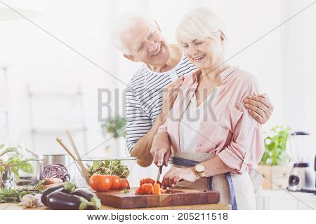 Elder Woman Is Cutting Tomatoes