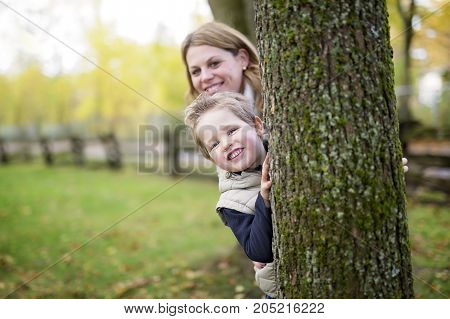 A Mother with the child in autumn season